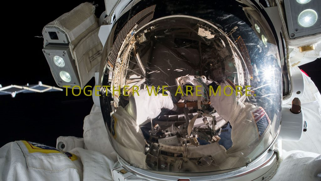 Picture of astronaut with Together We Are More overlaid in yellow text