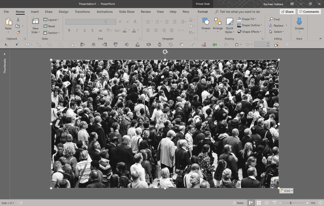 Screenshot of PowerPoint, with full bleed image of a busy crowd